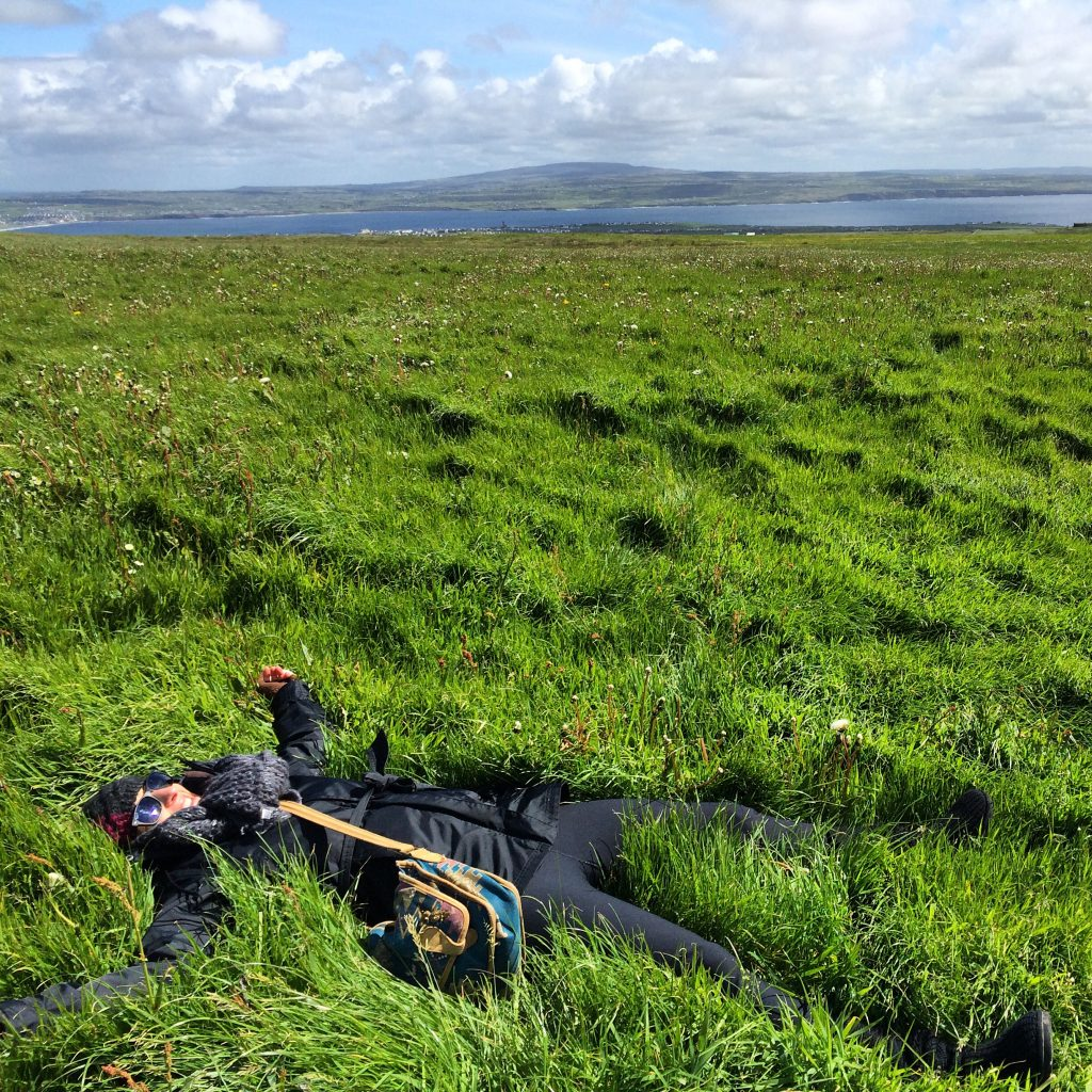 """<font size=""""5""""> Laying in the greenest, softest grass in the world at the top of the Cliffs of Moher in County Clare, Ireland.</font>"""