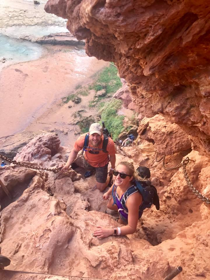 hiking down mooney falls cliff